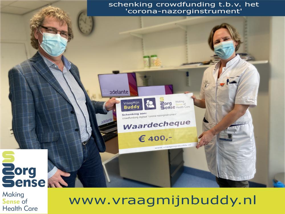 Uitreiking cheque door Gerard Castermans aan Janine verbunt